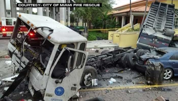 Garbage truck driver survives 100-foot plunge from Miami highway